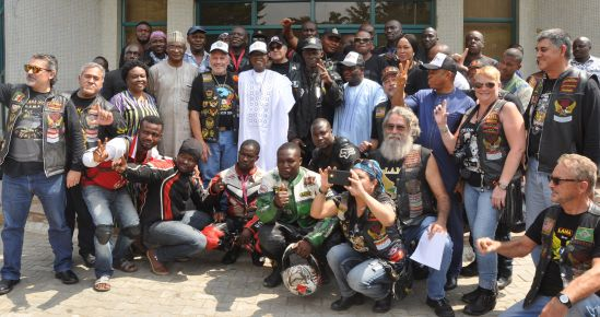 Minister of Information and Culture, Alhaji Lai Mohammed (middle), in a group photograph with members of the Latin America Motorcyclists Association (LAMA) in Abuja on Monday, when LAMA visited the Minister ahead of their tour of heritage sites and museums across the country.